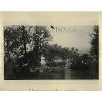 1924 Press Photo Mrs. Clem Shaner in her flower garden in her city home