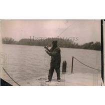 1919 Press Photo Scene from a local dock, man w/ his fishing rod ready to fish