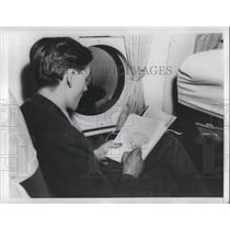 1948 Press Photo Man on a plane in window seat for ocean air travel