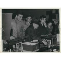 1940 Press Photo men at toy counter during a store White Elephant Sale