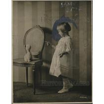 1918 Press Photo Adorable Girl in Batiste Dress Plays With Lamb Stuffed Animal