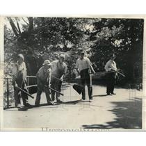 1936 Press Photo Men armed with Riot guns, gas bombs, pichforks, brooms & bats