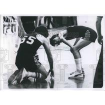 Press Photo John Toth bends over to check teammate Neal Ginley