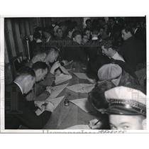 1939 Press Photo Group of men filing out applications for work In California