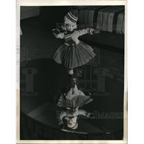 1939 Press Photo A dancing doll on a homes table