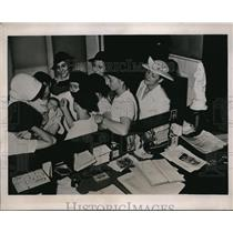 1936 Press Photo French Girl Scouts visit and carry a baby at the Founding Hosp.