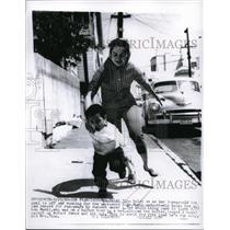 1960 Press Photo Mrs. Heidi Tino chases 3 yr old son, Monti, San Francisco