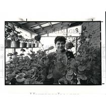 1988 Press Photo Curt Boehringer Surrounded by Geraniums