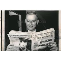 1963 Media Photo Bertman Powers grins as he reads the copy of New York post