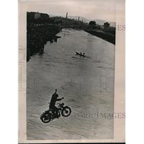 1936 Media Photo Austrian soldier leaps motorcycle into Danube canal