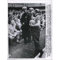 1958 Press Photo Sid Borgia, Referee, Signaling For Crowd Member to be Ejected