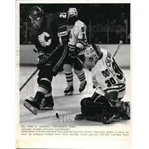 1989 Press Photo Blackhaw goalie Alain Chevrier saves vs Flames Joel Otto