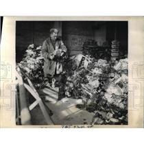 1944 Press Photo American Soldier Examines Engine Parts, German Slave Labor Camp