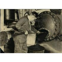 1924 Press Photo Worker Pulls Hydrolized Sawdust from Factory Retort