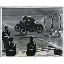 1959 Press Photo Daredevil motorcycle riders zip thru flaming hoops - nex17241