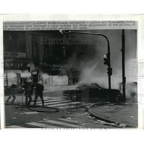 1973 Press Photo Firemen Extinguish Car After Protesters Lit It on Fire in