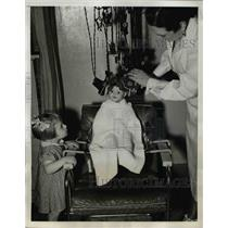 1938 Press Photo Barbara Louise & a doll in a hairdressers chair