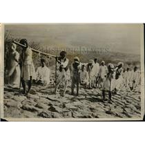 1928 Press Photo Jain Pilgrims Climbing Rocky Hill, India