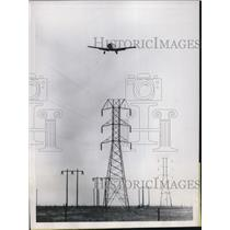 1951 Press Photo Telephone Company officials Hire Planes To Shake Ice From Wire