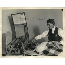 1929 Press Photo Fire Chief William P. Cooper, operates inhalator to save life