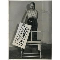 1932 Press Photo Dolly Coburn with huge stamp sign for Olympics