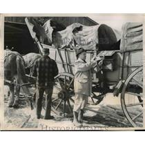 1956 Press Photo Sterling D. Emerson Mailing Using Conestoga Wagon Letter Box