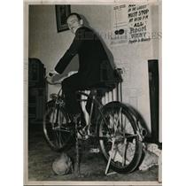 1937 Press Photo Harold Hulen on a bicycle with ball and chain on his ankle