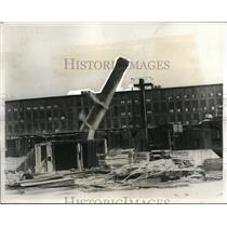 1932 Press Photo In order to save taxes this 250 foot chimney in a mill in