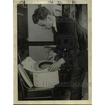 1920 Press Photo Economical man sunk his straw lid in camphor balls