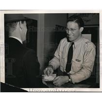1940 Press Photo Jim Moffity behind the ticket counter at Hartford