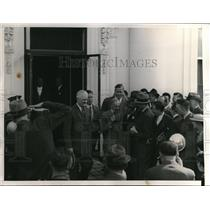 1938 Press Photo Henry Ford escorted by H Cunningham, surrounded by reporters