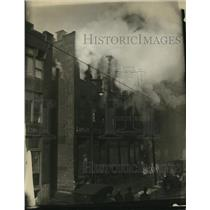 1925 Press Photo Firemen battle blaze as Chief Art Seyfrick directs them