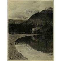 1924 Press Photo Reflection of campers' smoke at the medicine Lake