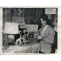 1949 Press Photo Miss Sara Tolentino Admires One Of The Dolls