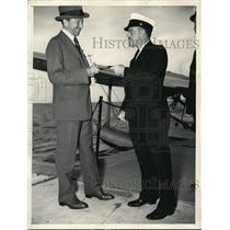 1938 Press Photo George W. Bacon Hands Ticket No. 1,000,001 To Ray Plummer