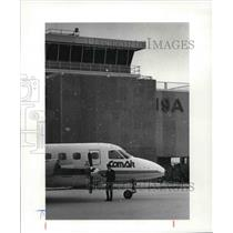 1983 Press Photo Conair Capt Russ Williams Checking his craft