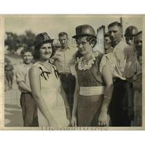 1933 Press Photo Mary Simon and Bertha Carloch wearing hard hats.