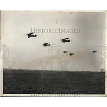 1931 Press Photo Pursuit squadron shown take off from field for aerial maneuver
