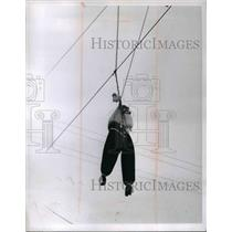 1966 Press Photo Cleveland Ohio prank of a figure hung from utility wires