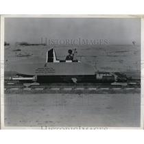 1950 Press Photo this 2300 lb sled like test carriage races down a 2 mile track