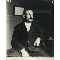 1911 Press Photo Ortie Manigal in his office