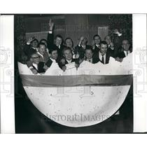 1971 Press Photo The 14 football pool winners ,in a egg during the celebrations