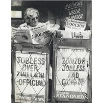 1980 Press Photo A paper seller more interested in the news than selling papers.