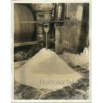 1939 Press Photo of a large pile of flour with a shovel sticking in it.