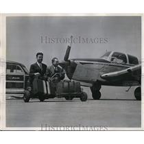 1947 Press Photo Dick Jenner, Don Mitchell on airscoots at an airport