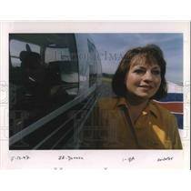 1997 Press Photo Ann Marie Donaca beside a helicopter - ora19941