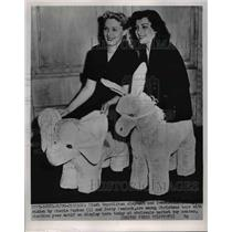 1952 Press Photo Chicago Donkey & elephant toys, Cherie Parker, B Peacock