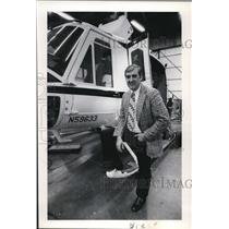 1978 Press Photo Brace Evergreen standing by a helicopter - ora03608