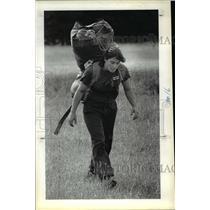 1983 Press Photo Sherrill King, packs her parachute gear after jump - ora46023