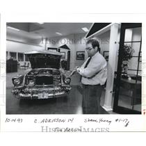 1993 Press Photo Jim Adkinson shown with a vintage car. - ora02296